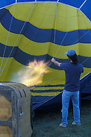 Hot Air Balloon Being Inflated with Burners On