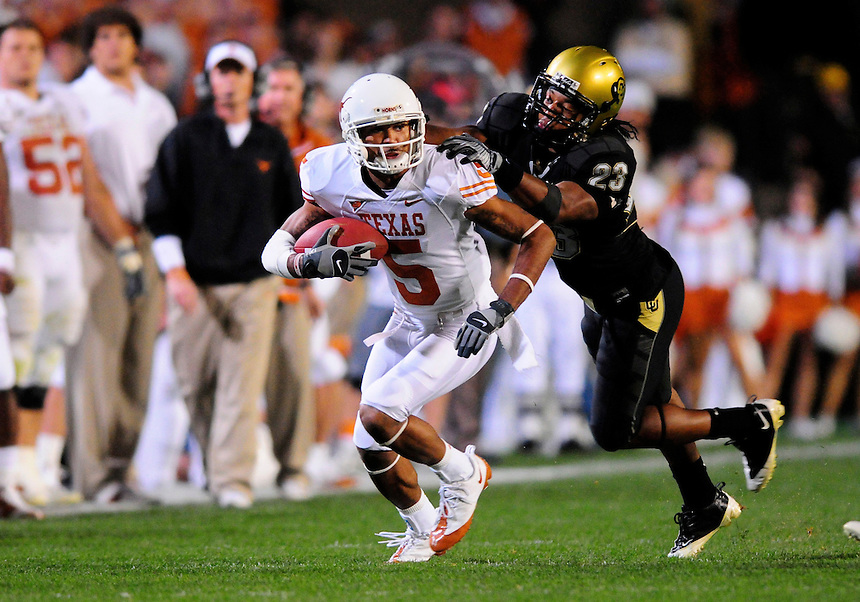 04 October 2008: Texas flanker Brandon Collins (5) rushes against Colorado. Tackling collins is Colorado cornerback Jalil Brown (23).  The Texas Longhorns defeated the Colorado Buffaloes 38-14 at Folsom Field in Boulder, Colorado. For Editorial Use Only
