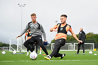Joe Rodon vies for possession with Matt Grimes of Swansea City during the Swansea City Training Session at The Fairwood Training Ground, Wales, UK. Tuesday 11th September 2018