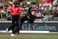 New Zealand's Mitchell Santner tries to stop a single off his bowling. New Zealand Blackcaps v England. One Day International Cricket. Seddon Park, Hamilton, New Zealand on Sunday 25 February 2018.<br /> <br /> Copyright photo: &copy; Bruce Lim / www.photosport.nz