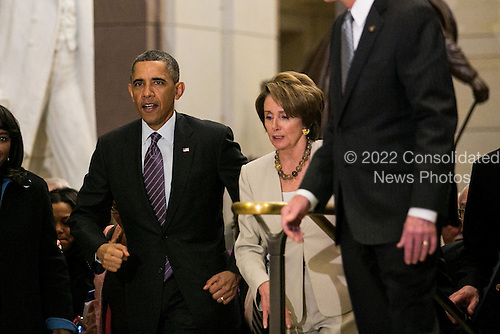United States President Barack Obama, walking with U.S. House Democratic Leader Nancy Pelosi (Democrat of California), leaves a meeting at the U.S. Capitol with the House Democratic Caucus, on Capitol Hill in Washington, Thursday, March 14, 2013. Earlier in the day, President Obama also met with the Senate Republican Conference. .Credit: Drew Angerer / Pool via CNP