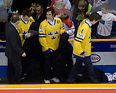 Oliver Ekman Larsson (Sweden - 3), Marcus Johansson (Sweden - 11), Tim Erixon (Sweden - 4) - Team Sweden celebrates after defeating Team Switzerland 11-4 to win the bronze medal in the 2010 World Juniors tournament on Tuesday, January 5, 2010, at the Credit Union Centre in Saskatoon, Saskatchewan.
