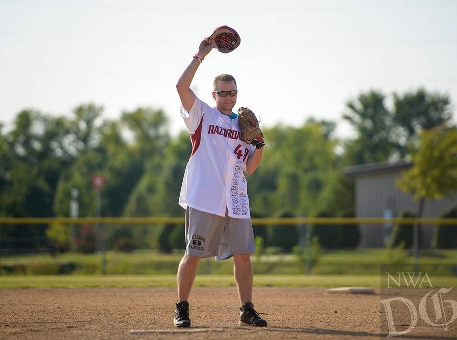 NWA Democrat-Gazette/CHARLIE KAIJO Matt Mika waves at fans before throwing the first pitch during the Tyson Chicken annual softball tournament, Friday, August 3, 2018 at the Rogers Regional Sports Park in Rogers. <br />
