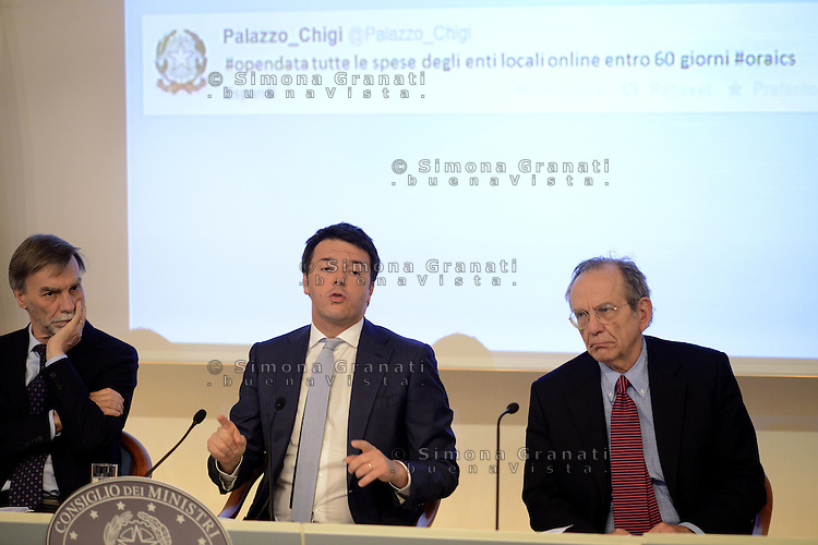 Roma 18 Aprile 2014<br /> Il primo ministro Matteo Renzi, durante la  conferenza stampa a Palazzo Chigi, riferisce sulle  misure sul Bonus Irpef e di altri interventi di politica economica decisi al  termine del Consiglio dei Ministri n&deg;14.<br />  Graziano Delrio, Matteo Renzi, Pier Carlo Padoan.<br /> Twitter#palazzochigi<br /> Rome, Italy. 18th April  2014 -- Prime Minister Matteo Renzi reports on measures that will be undertaken in the field  economic policy interventions and tax burden reductions in the press room at the Palazzo Chigi. -- The Italian Premier, Matteo Renzi announced new measures that will be undertaken in the field economic policy interventions, and tax burden reductions in the hopes of stimulating the economy.
