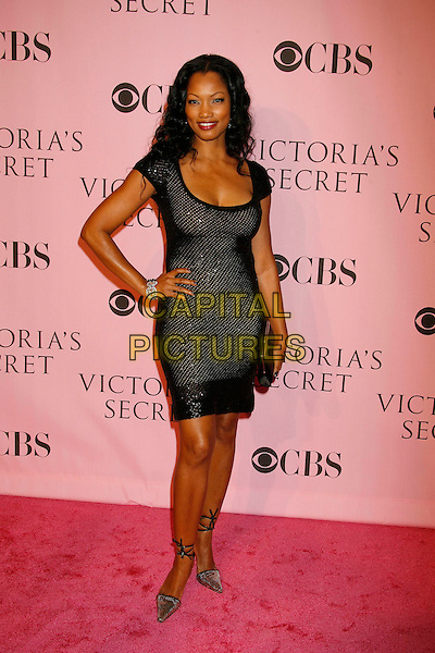 GARCELLE BEAUVAIS-NILON.The Victoria's Secret Fashion Show held at the Kodak Theatre, Hollywood, California, USA,16 November 2006..full length black dress hand on hip.CAP/ADM/RE.©Russ Elliot/AdMedia/Capital Pictures.