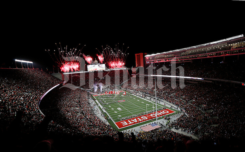 The Ohio State Buckeyes run on to the field before the college football game between the Ohio State Buckeyes and the Minnesota Golden Gophers at Ohio Stadium in Columbus, Saturday night, November 7, 2015. As of half time the Ohio State Buckeyes led the Minnesota Golden Gophers 14 - 0. (The Columbus Dispatch / Eamon Queeney)