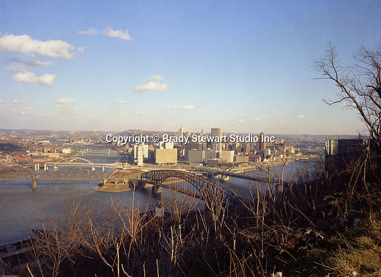 Pittsburgh PA: View of the skyline and city of Pittsburgh from Mt Washington - 1965.  Photo was taken  right after the completion of the Gateway Towers and the construction of the Allegheny Center Mall