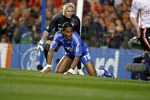 4 April 2007: Chelsea striker Didier Drogba on his knees during the UEFA Champions League quarter final first leg, between Chelsea and Valencia played at Stamford Bridge. The game ended in a 1-1 draw Photo: Glyn Kirk/Action Plus...soccer football 070404  player