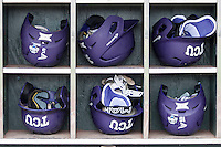 TCU Horned Frogs helmet rack at the NCAA College World Series on June 14, 2015 at TD Ameritrade Park in Omaha, Nebraska. TCU defeated LSU 10-3. (Andrew Woolley/Four Seam Images)