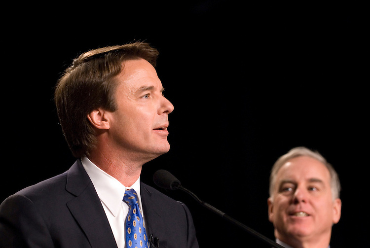 Former Sen. John Edwards, D-N.C., speaks during the Democratic National Committee winter meeting as DNC chairman Howard Dean listens at the Washington Hilton on Friday, Feb. 2, 2007.