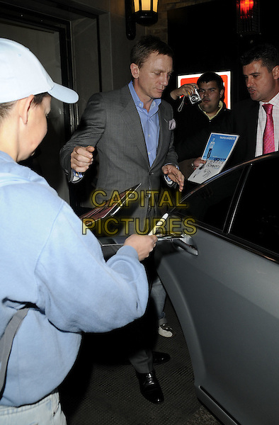 DANIEL CRAIG.Spotted at The Ivy Restaurant, London, England..June 23rd, 2009.full length grey gray suit jacket blue shirt photographers press paparazzi side view .CAP/CAN.©Can Nguyen/Capital Pictures.