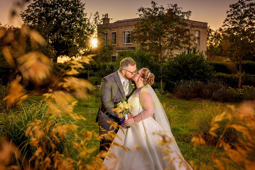 Beautiful early evening photo captured of the Bride and Groom at sunset with Shortmead House in the background
