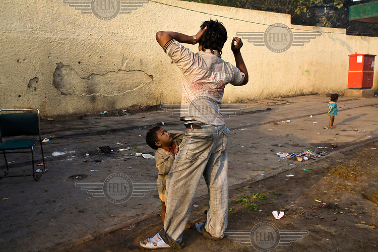 30 year old Baddhi Lal with one of his children, Karan, in Karol Bagh, New Delhi.