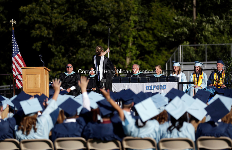 Oxford, CT- 10 June 2016-061016CM08-  Oxford High School principal Dorothy Potter takes a photo with graduates during commencement exercises in Oxford on Friday.     Christopher Massa Republican-American
