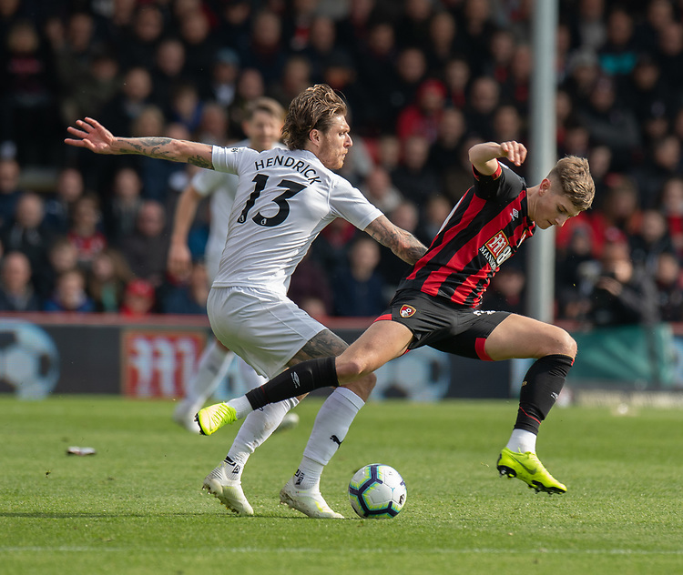Bournemouth's David Brooks (right) is tackled by Burnley's Jeff Hendrick (left) <br /> <br /> Photographer David Horton/CameraSport<br /> <br /> The Premier League - Bournemouth v Burnley - Saturday 6th April 2019 - Vitality Stadium - Bournemouth<br /> <br /> World Copyright © 2019 CameraSport. All rights reserved. 43 Linden Ave. Countesthorpe. Leicester. England. LE8 5PG - Tel: +44 (0) 116 277 4147 - admin@camerasport.com - www.camerasport.com