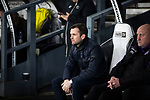 Visiting manager Nathan Jones sitting in the technical area before Derby County played Stoke City in an EFL Championship match at Pride Park Stadium. Opened in 1997, it is the 16th-largest football ground in England and the 20th-largest stadium in the United Kingdom. The fixture ended in a 0-0 draw watched by a crowd of 25,685.