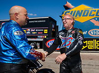 Apr 23, 2017; Baytown, TX, USA; NHRA top fuel nitro Harley Davidson rider Jay Turner (left) is congratulated by Bob Malloy as he celebrates after winning the Springnationals at Royal Purple Raceway. Mandatory Credit: Mark J. Rebilas-USA TODAY Sports