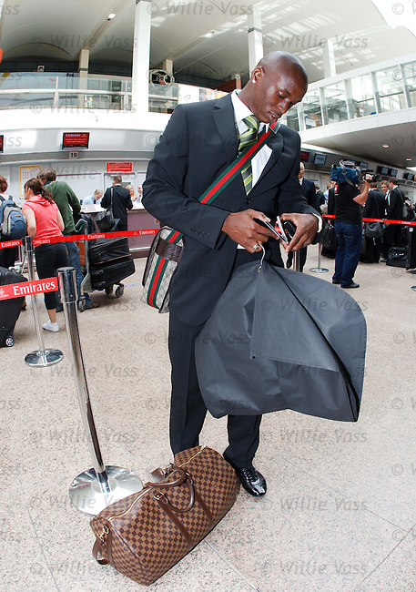 Marc-Antoine Fortune checks his passport before boarding his Emirates flight to Brisbane