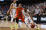 12 March 2015: Notre Dame's Demetrius Jackson (11) and Miami's Manu Lecomte (BEL) (20). The Notre Dame Fighting Irish played the University of Miami Hurricanes in an NCAA Division I Men's basketball game at the Greensboro Coliseum in Greensboro, North Carolina in the ACC Men's Basketball Tournament quarterfinal game. Notre Dame won the game 70-63.