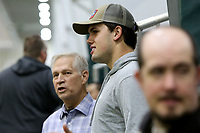 NWA Democrat-Gazette/DAVID GOTTSCHALK  Chris Mortensen (left), National Football League Analyst, speaks with former Razorback and Los Angeles Charger Hunter Henry Wednesday, March 15, 2017, before the Arkansas Pro Day inside the Walker Pavilion on the campus of the University of Arkansas in Fayetteville.