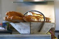French bread baguette in a basket. Chateau Lapeyronie, Cotes de Castillon, Bordeaux, France