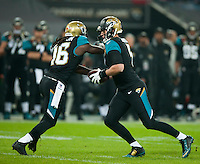 09.11.2014.  London, England.  NFL International Series. Jacksonville Jaguars versus Dallas Cowboys. Jaguars' Chad Henne (#7) hands off to Jaguars' Denard Robinson (#16)