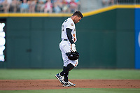 Yoan Moncada (10) of the Charlotte Knights walks back to the dugout after having been thrown out attempting to steal second base during the game against the Indianapolis Indians at BB&T BallPark on June 16, 2017 in Charlotte, North Carolina.  The Knights defeated the Indians 12-4.  (Brian Westerholt/Four Seam Images)
