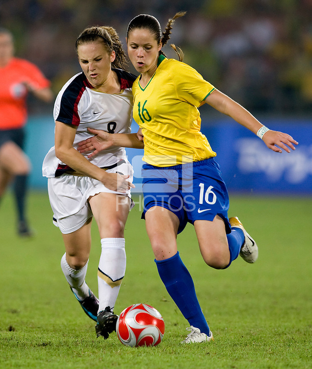 USWNT forward (8) Amy Rodriguez fights for the ball with Brazilian defender (16) Erika while playing for the gold medal at Workers' Stadium.  The USWNT defeated Brazil, 1-0, during the 2008 Beijing Olympic final in Beijing, China.