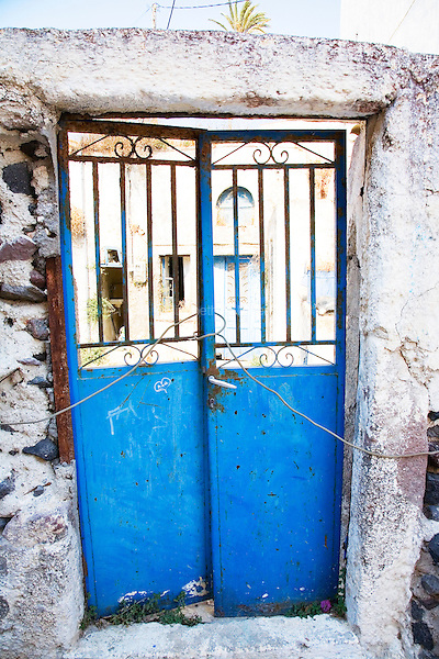 An old earthquake-ravaged doorway in the town of Megalochori in Santorini, Greece on July 7, 2013.