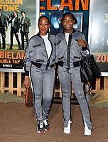 "LOS ANGELES, USA. October 11, 2019: Tichina Arnold & Alijah Kai Haggins at the premiere of ""Zombieland: Double Tap"" at the Regency Village Theatre.<br /> Picture: Paul Smith/Featureflash"