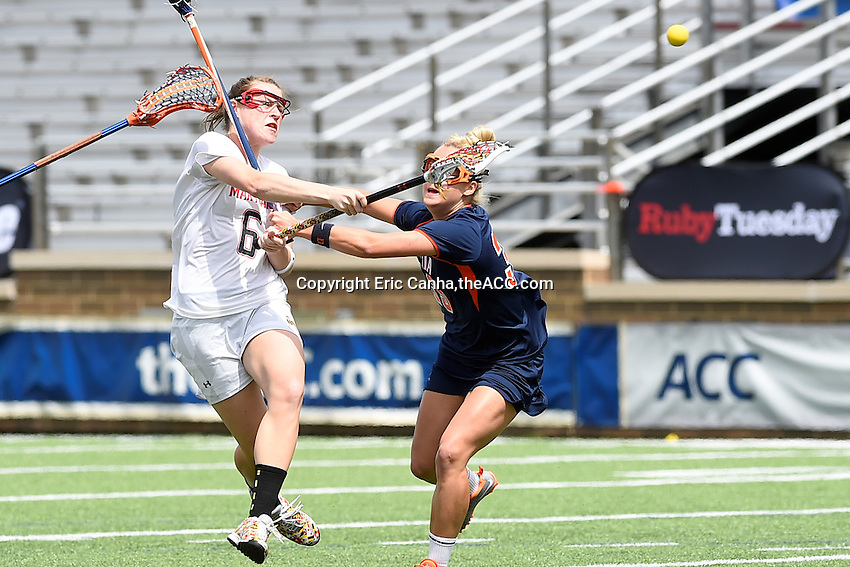 Maryland's Kelly McPartland (6) shoots while being defended by Virginia's Wyatt Whitley (33) during the 2014 ACC Women's Lacrosse Semifinals in Boston, MA, Friday, April 25, 2014. (Photo by Eric Canha,<br /> theACC.com)