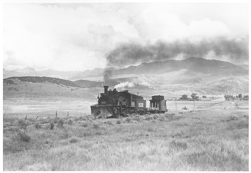 3/4 view of K-27 #461 pluuing gondola and caboose.<br /> RGS  outside Ridgway, CO  Taken by Krause, John - 8/1952