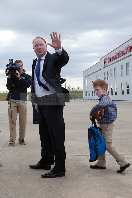 New University of Kentucky head football coach Mark Stoops and his son Zack at the R.J. Corman Hanger in Nicholasville, Ky on December 2, 2012. Photo by Adam Chaffins | Staff
