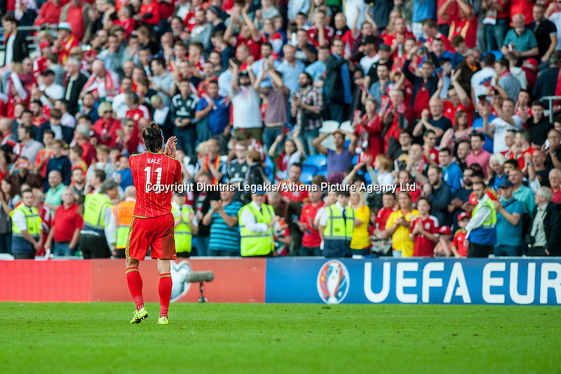 Gareth Bale  of Wales  applauds fans after drawing their UEFA EURO 2016 Group B qualifying round match held at Cardiff City Stadium, Cardiff, Wales, 06 September 2015. EPA/DIMITRIS LEGAKIS