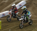 Grant Mcdonald (#282) and Zoey Wilde (#168)  compete in the Ultracross 50cc 4-8 class in the Arena Cross motorcycle event held in the Reno Livestock Events Center on Saturday April 28, 2018.