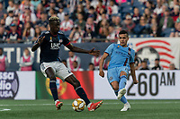 FOXBOROUGH, MA - SEPTEMBER 29: Jesus Medina #19 of New York City FC passes the ball as Wilfried Zahibo #23 of New England Revolution closes during a game between New York City FC and New England Revolution at Gillette Stadium on September 29, 2019 in Foxborough, Massachusetts.