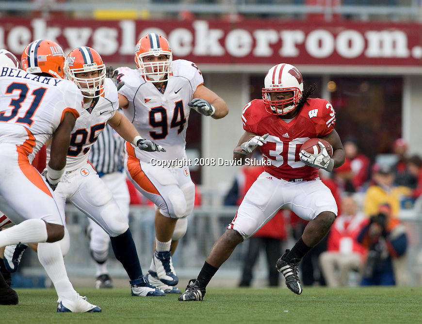 MADISON, WI - OCTOBER 25: Running back Zach Brown #30 of the Wisconsin Badgers carries the ball against the Illinois Fighting Illini at Camp Randall Stadium on October 25, 2008 in Madison, Wisconsin. The Badgers beat the Fighting Illini 27-17. (Photo by David Stluka)