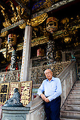 Chairman of the Board of Trustees, Leong San Tong Khoo Kongsi (or Khoo Kongsi), Dato' Seri Khoo Keat Siew poses in front of the clan house in the UNESCO heritage city of Georgetown in Penang, Malaysia. Photo: Sanjit Das/Panos