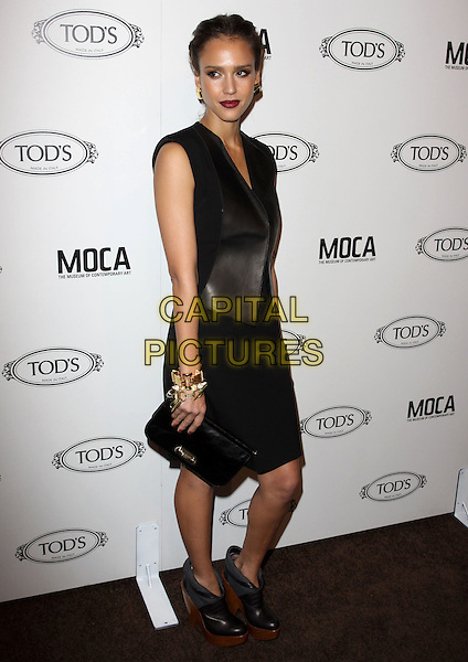 JESSICA ALBA.Tod's Beverly Hills boutique Grand Opening held At Tod's Boutique, Beverly Hills, California, USA. .April 15th, 2010 .full length sleeveless black dress vest waistcoat wedges ankle boots wedge wooden clutch bag gold bracelets .CAP/ADM/KB.©Kevan Brooks/AdMedia/Capital Pictures.
