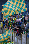 Runcorn Town 1 Runcorn Linnets 0, 26/12/2013. The Pavilions, North West Counties League Premier Division. Away supporters cheering on their team during the first-half of the Boxing Day derby match between Runcorn Town and visitors Runcorn Linnets at the Pavilions, Runcorn, in a top-of the table North West Counties League premier division match. Runcorn Linnets won 1-0 and overtook their neighbours at the top of the league in a game watched by 803 spectators. Runcorn Linnets were a successor club to Runcorn FC, one of England foremost non-League clubs of the 1970s and 1980s. Photo by Colin McPherson.