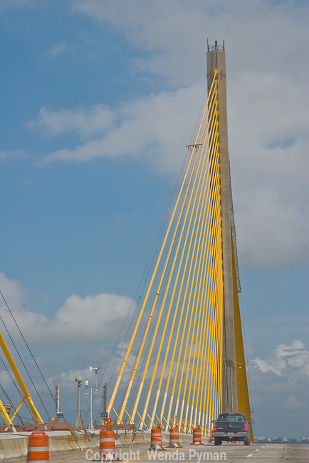 The yellow gold cables add drama as one drives over the Skyway bridge.