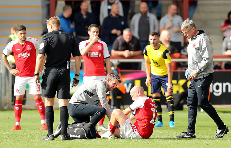 Fleetwood Town's Paddy Madden receives treatment<br /> <br /> Photographer Rich Linley/CameraSport<br /> <br /> The EFL Sky Bet League One - Fleetwood Town v Oxford United - Saturday 7th September 2019 - Highbury Stadium - Fleetwood<br /> <br /> World Copyright © 2019 CameraSport. All rights reserved. 43 Linden Ave. Countesthorpe. Leicester. England. LE8 5PG - Tel: +44 (0) 116 277 4147 - admin@camerasport.com - www.camerasport.com