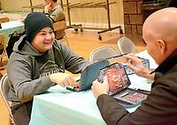 Janelle Jessen/Herald-Leader<br /> Jackson Boles, left, and his dad John Boles played Battleship during Family Game Night.