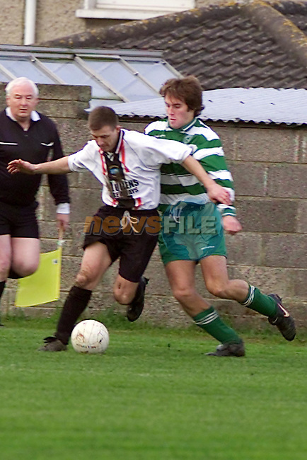 james Farrell keeps the Ball clear of the Workmans Defence..Picture Fran Caffrey Newsfile.
