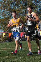 St. Vincent senior Isaac Baer battles a Glascow runner on his way to an 11th-place finish in the Class 1 race at the 2015 MSHSAA State Cross Country Championships.