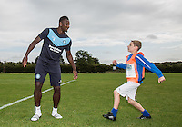 Current Internet sensation Taylor Hunt poses with his family and Aaron Pierre of Wycombe during Ballboy Taylor Hunt's visit to Wycombe Wanderers Training Ground, High Wycombe, England on 25 August 2015. Photo by Andy Rowland.