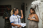RECIFE, BRAZIL - JANUARY 9: A worker from the Environmental Health Department speaks to a resident about how to take care of standing water, which provides perfect breeding ground for the zika-carrying mosquitoes, in Recife, Pernambuco, Brazil, on Saturday, Jan. 9, 2016<br /> <br /> The mosquito-borne Zika virus continues to spread in Brazil, alarming health officials and expecting mothers that their babies will be born with abnormal brain development called microcephaly. While researchers have yet to make a connection, Brazil has the highest number of babies born with mircocephaly - the most cases in Recife, Pernambuco - from mothers who tested positive to the Zika virus. There are about 3,530 suspected cases of zika-related microcephaly in Brazil.