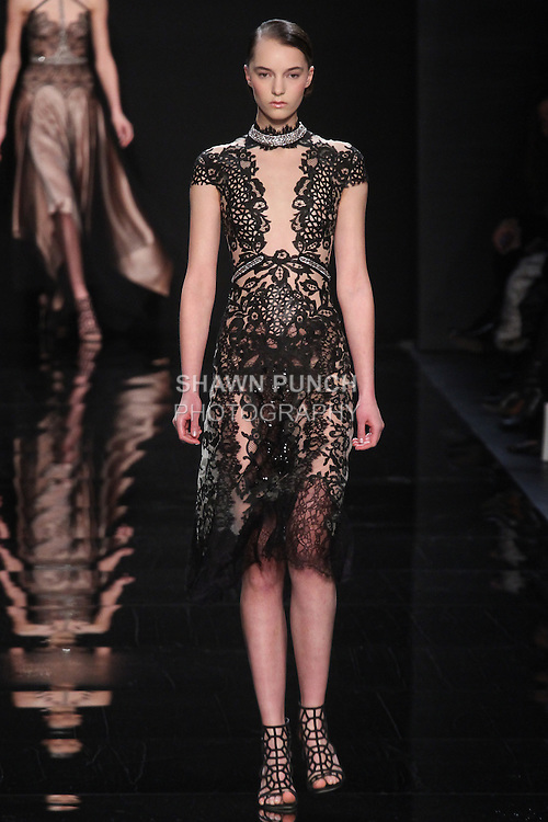 """Model walks runway in an ebony lace/leather embroidered dress from the Reem Acra Fall 2016 """"The Secret World of The Femme Fatale"""" collection, at NYFW: The Shows Fall 2016, during New York Fashion Week Fall 2016."""