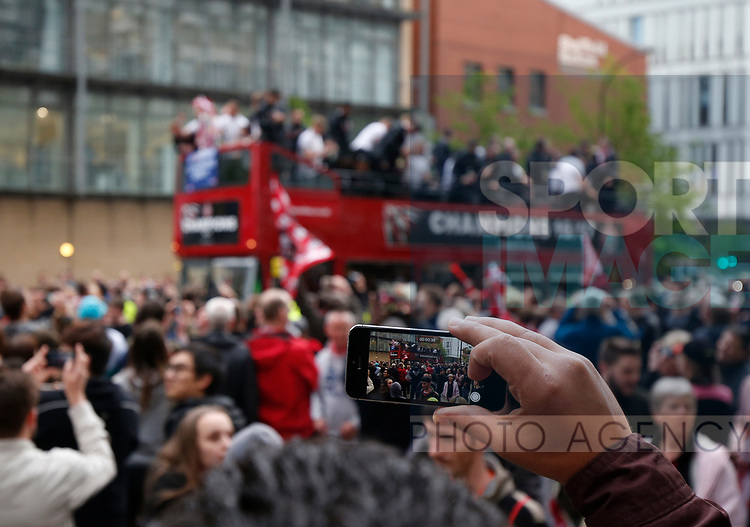 Fans film the tour during the open top bus parade from Bramall Lane Stadium to Sheffield Town Hall, Sheffield. Picture date: May 2nd 2017. Pic credit should read: Simon Bellis/Sportimage