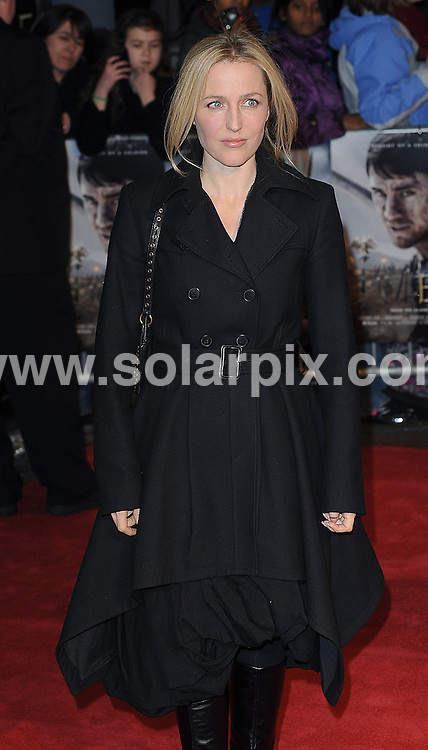 **ALL ROUND PICTURES FROM SOLARPIX.COM**                                             **WORLDWIDE SYNDICATION RIGHTS**                                                                                  Red carpet arrivals at the UK premiere of The Eagle. Held at The Empire, Leicester Square, London This pic: Gillian Anderson JOB REF: 12943 TLP DATE: 09_03_.2011                                                         **MUST CREDIT SOLARPIX.COM OR DOUBLE FEE WILL BE CHARGED**                                                                      **MUST AGREE FEE BEFORE ONLINE USAGE**                               **CALL US ON: +34 952 811 768 or LOW RATE FROM UK 0844 617 7637**
